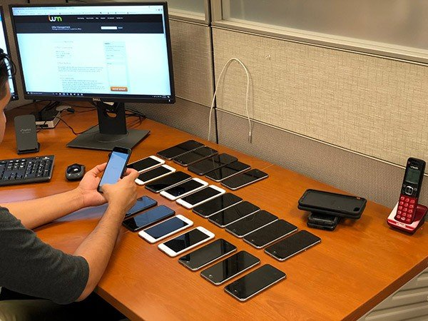 Picture of an employee testing mobile phones